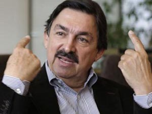 Gomez, the head of Mexico's mining union, gestures during an interview in Vancouver