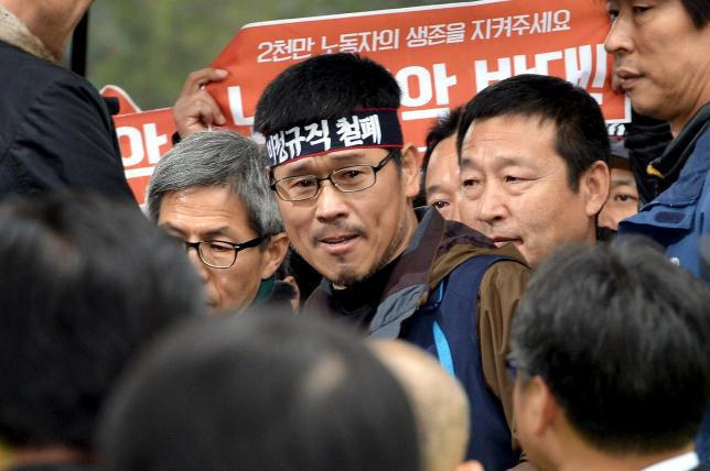 Han Sang-Gyun, the head of the Korean Confederation of Trade Unions (KCTU), reacts before surrendering voluntarily to the police at Jogye temple in Seoul, South Korea, December 10, 2015. REUTERS/News1